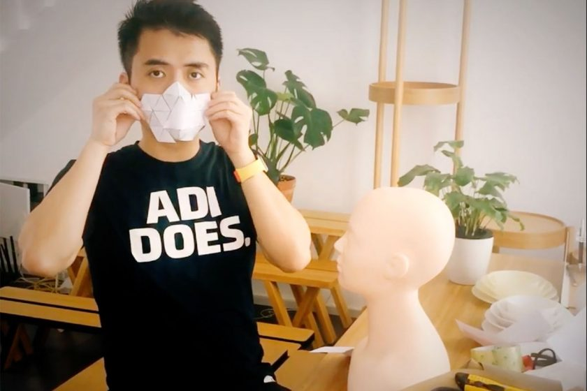 Miles Min Chen, mulitdisciplinary designer from China, showing a paper mock-up of a COVISD_19 mask design.